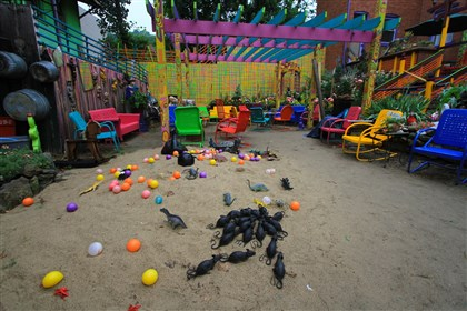 Randyland July 2014 Those are, in fact, only toy rats occupying a part of the Randyland courtyard beach.