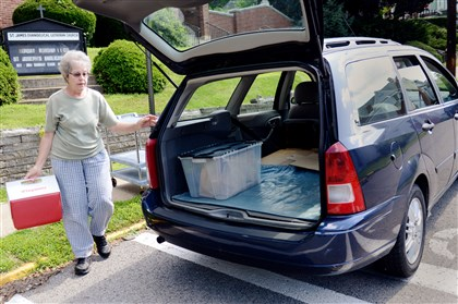 20140717ppMealsOnWheels2ALLZONE-1 Carol Lee, of Franklin Park, picks up the meals for delivery on her route every Thursday from the St. James Evangelical Lutheran church where she volunteers with the North Boros Sewickley Meals on Wheels.