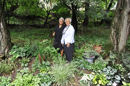 20140719SSgardenersMag1 Carolyn Collier, left, and Agnes Curry stand in Ms. Collier's Penn Hills garden before the the monthly meeting of the Stoop N' Bend gardening club.