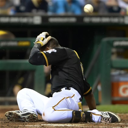 20140718pdPiratesSports06-1 Starling Marte drops to the ground after being hit by pitch against the Rockies at PNC Park on July 18.
