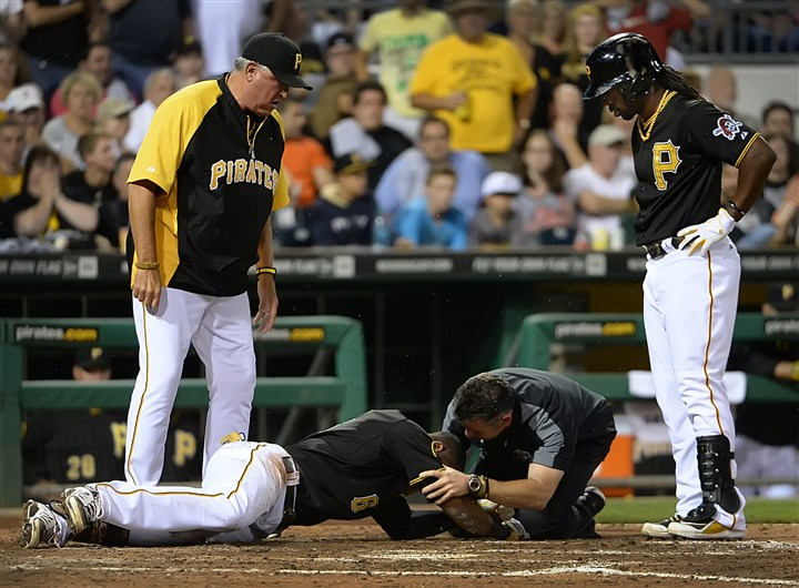 20140718pdPiratesSports05 Pittsburgh Pirates Starling Marte drops to the ground after being hit by pitch Friday against the Rockies at PNC Park.
