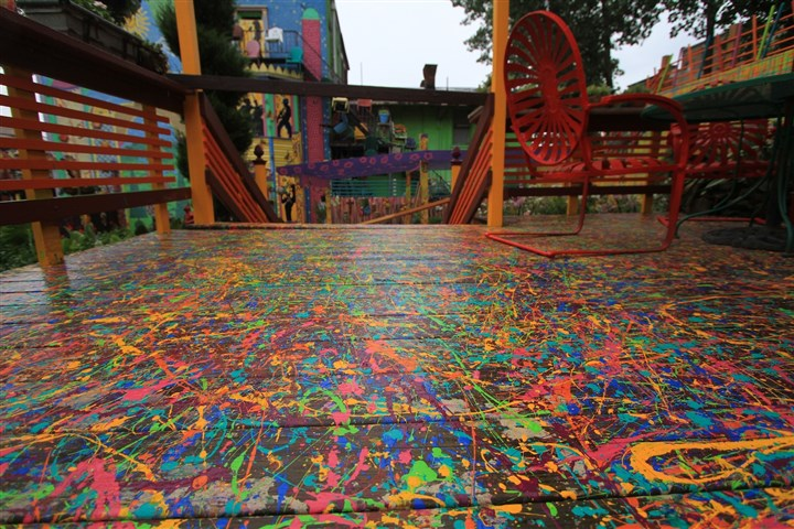 Randyland July 2014 A Jackson Pollock-like design covers a small deck in the Randyland courtyard.