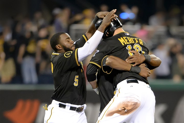 20140719pdPiratesSports07 The Pirates' Jordy Mercer is mobbed after hitting a game winning single against the Rockies in the 11th inning at PNC Park on Saturday.