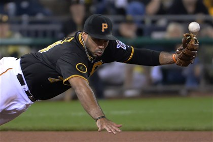 20140719pdPiratesSports08 Pittsburgh Pirates third baseman Pedro Alvarez makes error on a ball against the Colorado Rockies at PNC Park.