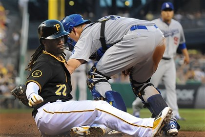 20140721pdPiratesSports04-1 Andrew McCutchen slides safely past the tag of Dodgers catcher AJ Ellis at PNC.