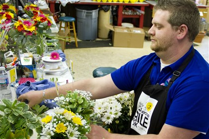 20140721hoEFLORIST0724east John Lechliter, manager, wedding consultant and designer at Lea's Floral Shop in East McKessport, arranges bouquets for delivery to local care facilities.