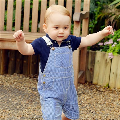 "PrinceGeorge Britain's Prince George walks during a July 2 visit to the ""Sensational Butterflies"" exhibition at the Natural History Museum, London. He turns 1 today."