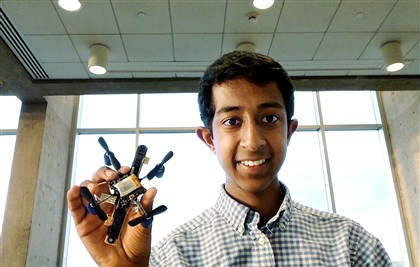 20140721homihirgarimella0722Ahealth-1 Mihir Garimella with the flying robot on which his project was based. He was one of the 90 Google Science Fair regional finalists and 15 Computer Science Award nominees in the world.