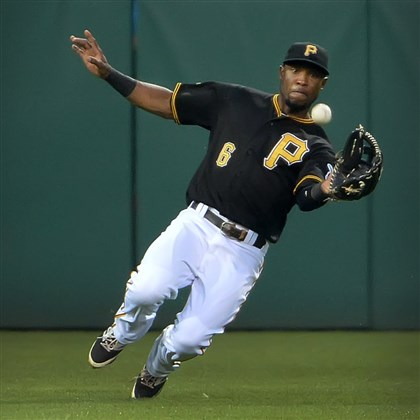 20140721pdPiratesSports03 Pirates left fielder Starling Marte makes diving catch on ball.