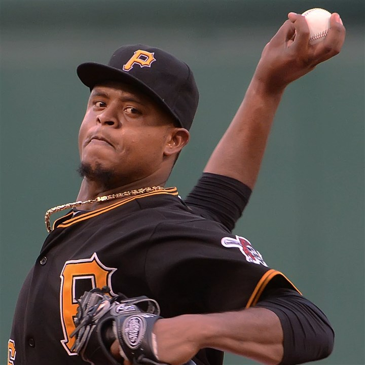 20140721pdPiratesSports01 Pirates starting pitcher Edison Volquez delivers against the Dodgers at PNC Park.