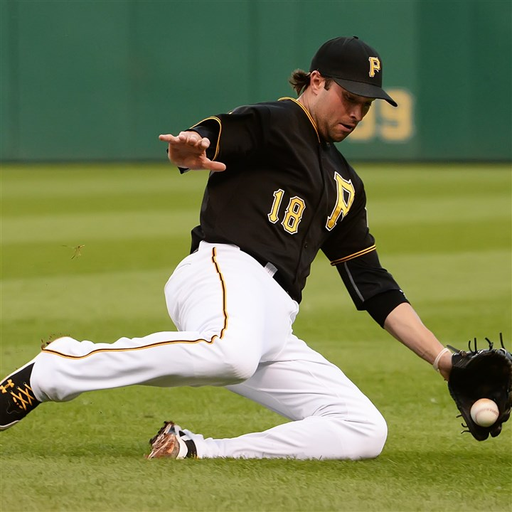 20140721pdPiratesSports05-2 Pirates second baseman Neil Walker dives for a ball hit by the Dodgers' Dee Gordon, who was called out at first at PNC Park Monday night.