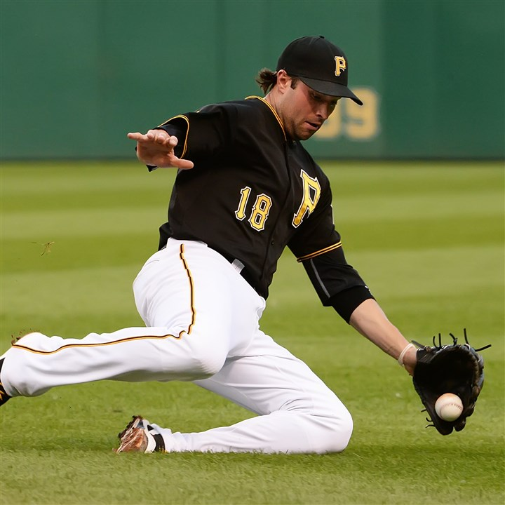 walker0811 Pirates second baseman Neil Walker dives for a ball against the Dodgers at PNC Park.