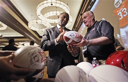 Strong0723 Texas head coach Charlie Strong, left, signs footballs for Peter Irwin at the Big 12 Conference NCAA college football media days Tuesday in Dallas.