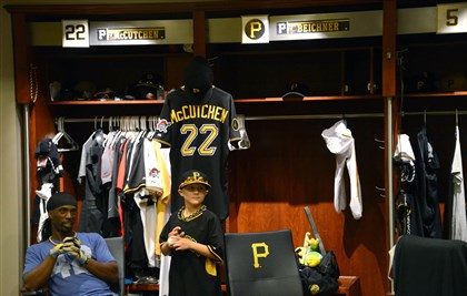 20140722MWHmakeawishSports08-7 Matthew Beichner, 12, stands in front of his own personal locker in the Pirates Clubhouse, while talking with center fielder Andrew McCutchen, his favorite player.