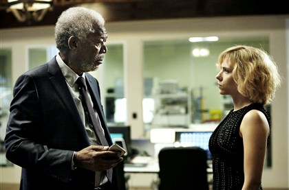 "Lucy3-3 Professor Norman (Morgan Freeman) attempts to comprehend Lucy (Scarlett Johansson) in ""Lucy."""