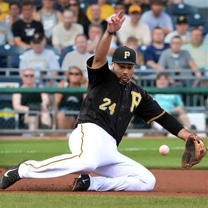 20140722pdPiratesSports03 Pirates third baseman Pedro Alvarez dives for ball hit by the Dodgers' Justin Turner for a single.