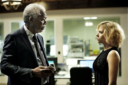"Lucy3-3 Morgan Freeman as Professor Norman attempts to comprehend Lucy, played by Scarlett Johansson, and the power of her mind in ""Lucy."""