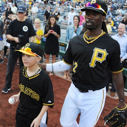 20140722MWHmakeawishSports15-14 Andrew McCutchen walks with Matthew Beichner toward the field for the game's first pitch Tuesday.