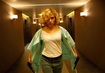 "Lucy1-1 Writer/director Luc Besson directs Scarlett Johansson in ""Lucy,"" an action-thriller that examines the possibility of what one human could truly do if he or she unlocked 100 percent of her brain capacity and accessed the furthest reaches of her mind."