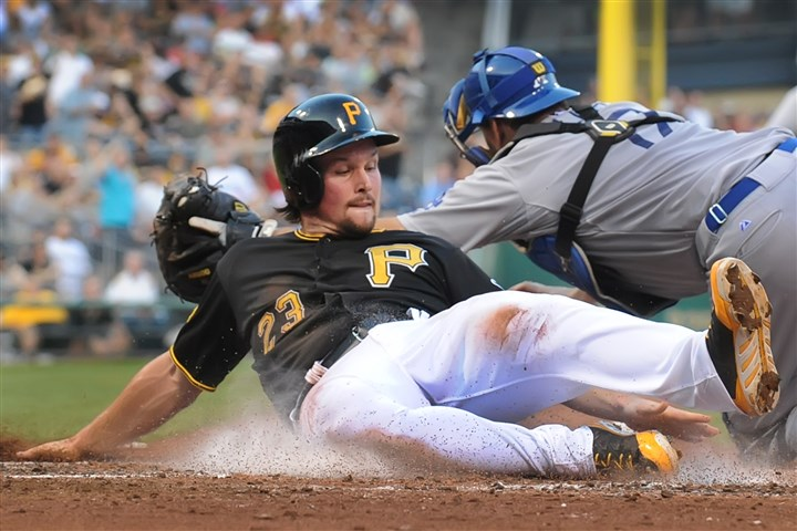 20140722pdPiratesSports07-4 Pittsburgh Pirates outfielder Travis Snider slides safely home past Dodgers catcher A.J. Ellis at PNC Park.