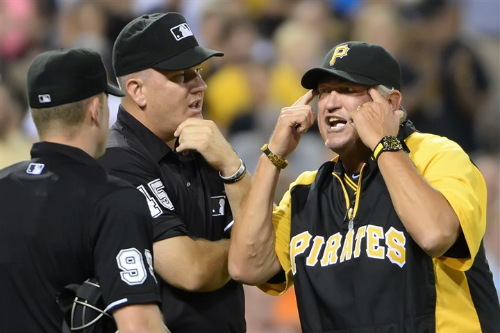 20140722pdPiratesSports10-1 Pirates manager Clint Hurdle argues with umpires after pitcher Justin Wilson was ejected from the game.