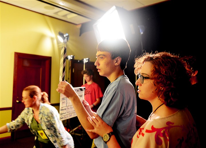 20140722RARlocalautism2-1 Tommy McShea, 16, waits to clap the slate while working on a film.