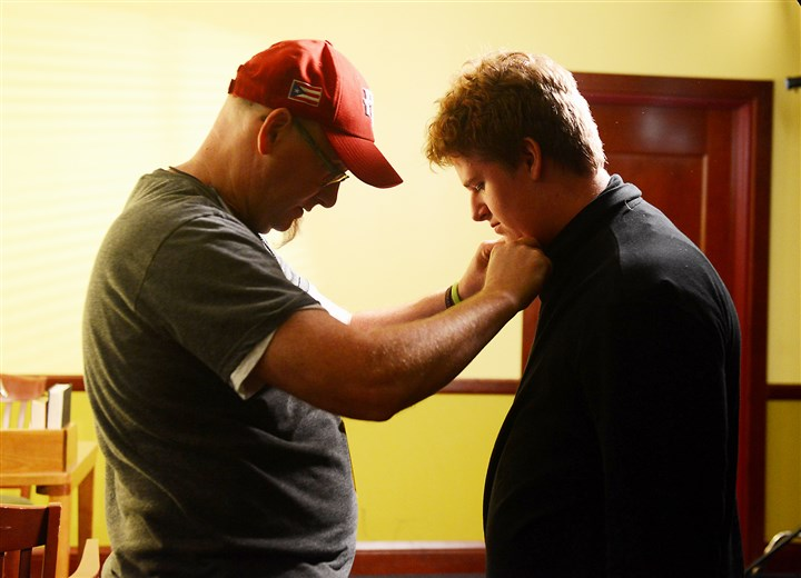 20140722RARlocalautism3-2 Crew member Jim Ledoux puts a microphone on actor Patch Twigger, who is participating in the Joey Travolta Short Film Camp at Winchester Thurston School in Shadyside. The camp is an inclusive program for teens and adults with autism spectrum disorders.