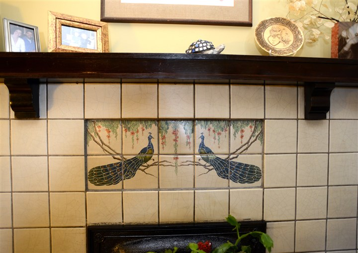 2014630RARmagbrentwood5-9  Original peacock tiles on the fireplace in the Sheppards' living room.