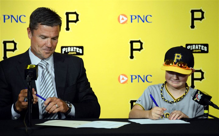 20140722MWHmakeawishSports06-5 Pittsburgh Pirate's President Frank Coonelly, left, surprises 12-year-old Matthew Beichner, a guest of the Pirates and the Make-A-Wish Foundation, by signing him to a one-day contract with the team.
