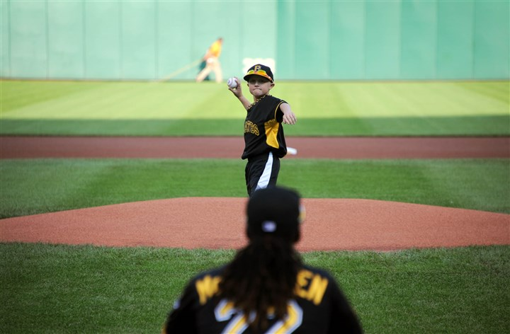20140722MWHmakeawishSports16-15 Matthew Beichner, 12, throws the first pitch to Pirates center fielder Andrew McCutchen before their game Tuesday against the Los Angeles Dodgers.