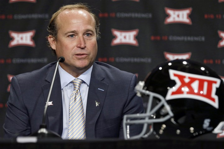 Holgorsen0723 West Virgina head coach Dana Holgorsen answers a question from a reporter during the NCAA college Big 12 Conference football media days in Dallas, Tuesday, July 22, 2014.
