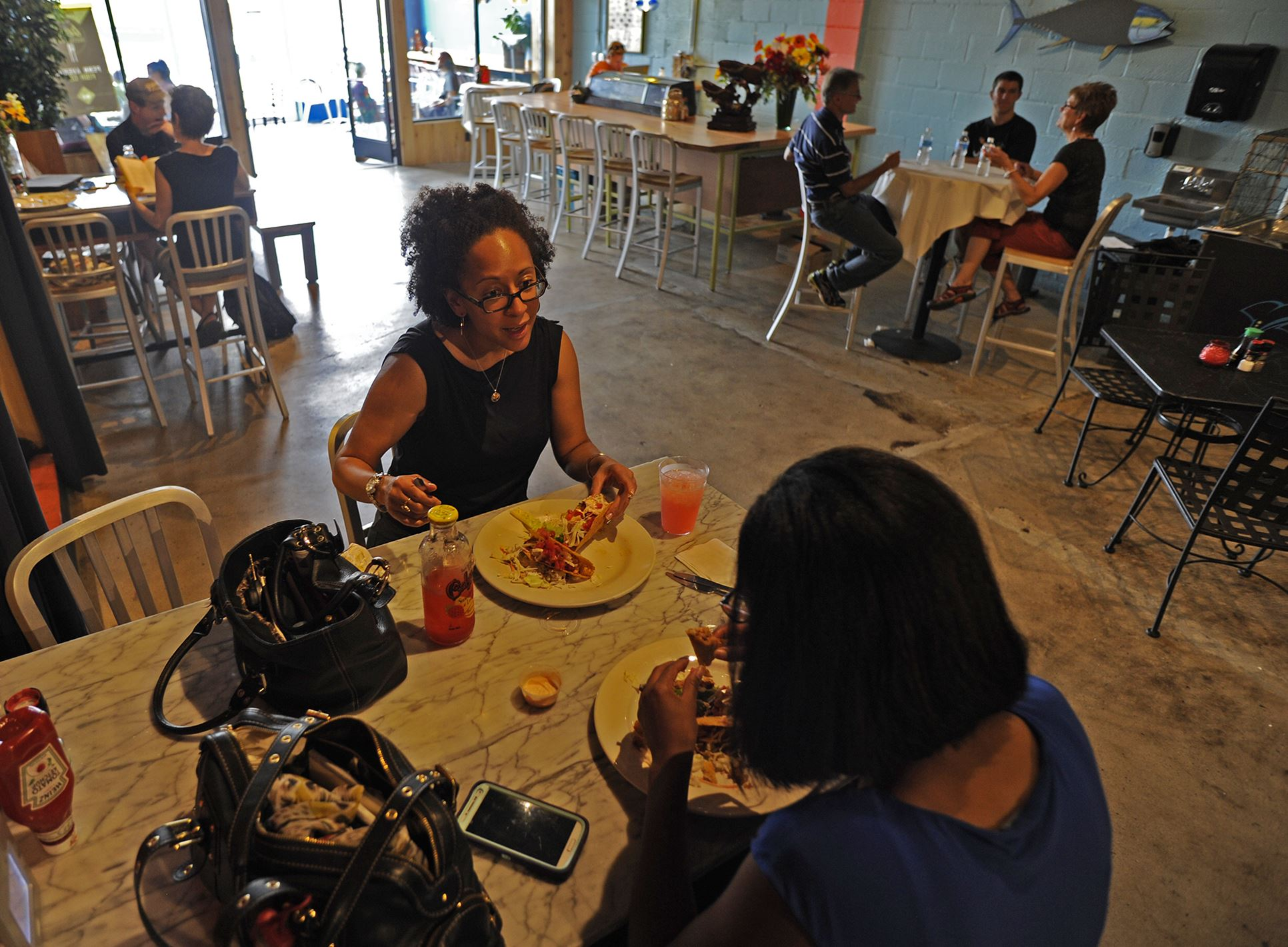 20140724CMTableMag001 Patrice Jenks Singleton, left, and Loriel Jenks, both of the North Side, dine in the newly remodeled Penn Avenue Fish Company in the Strip District.
