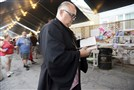 Father Tim Tomson prepares to lead a memorial service at St. Mary's Ukrainian Festival in McKees Rocks in 2014.