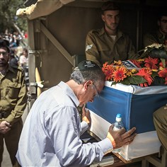 "9rb00kwt The father of Sergeant Max Steinberg grieves at his coffin during his funeral Wednesday in Jerusalem, Israel. As operation ""Protective Edge"" enters its 16th day, 29 Israeli soldiers have been killed and over 600 Palestinians have been killed in Gaza, the vast majority being civilians."
