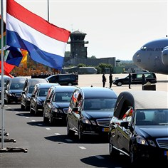 9rb00m4t-25 Hearses carrying coffins containing unidentified bodies from the crash of Malaysia Airlines Flight MH17 depart the airport Wednesday in Eindhoven, Netherlands.