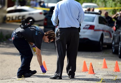 20140723MWHshootingLocal02-8 Forensic investigators mark shell casings at the scene of a shooting on Hickory Street at Jones Avenue in North Braddock.