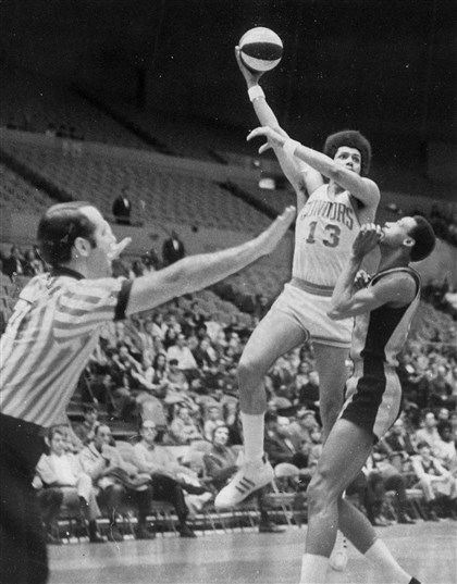 condorsAsports-1 Stew Johnson of the Pittsburgh Condors basketball team demonstrates his hook shot for Sam Robinson in a March 6, 1971 file photo,