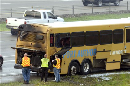 20140723dsPATBusFireLocal02.jpg A Port Authority bus is examined at the Kirwan Heights exit of Interstate 79 southbound early this morning. No passengers were on board and the driver was unhurt.