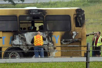 20140723dsPATBusFireLocal01.jpg A Port Authority bus is examined at the Kirwan Heights exit of Interstate 79 southbound early this morning. No passengers were on board and the driver was unhurt.