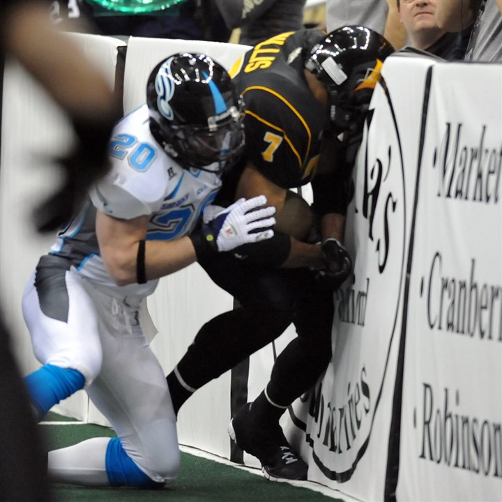 power0724 The AFL's Pittsburgh Power vs. Philadelphia Soul at Consol Energy Center for the team's first indoor football game on March 09, 2011. The Soul's Tanner Varner pushes the Power's Jason Willis into the wall.