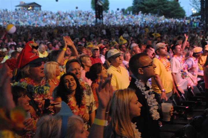 Jimmy Buffett fans Beach balls fly through the air and fans delight themselves to the music Jimmy Buffett Wednesday at the First Niagara Pavilion in Burgettstown, Pa.