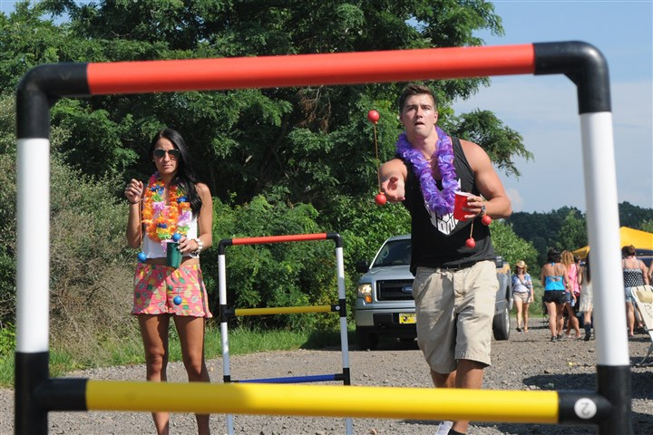 Tailgating for Buffett concert Danielle Konopski, of New Kensington, and Josh Russo, of Upper St. Clair, both 21, play a game Wednesday as they warm up before the Jimmy Buffett concert at the First Niagra Pavilion.