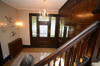 entryway features original woodwork The entryway features original woodwork.
