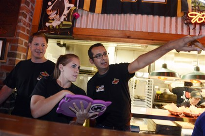 20140724bwNoWaitBus02-1 Texas Roadhouse hostess Natasha Scholl, center, uses a computer pad with a NoWait seating app to show how it works to NoWait board members Chris Olsen of Drive Capital, left, and Sean Ammirati of Birchmere Ventures, right.