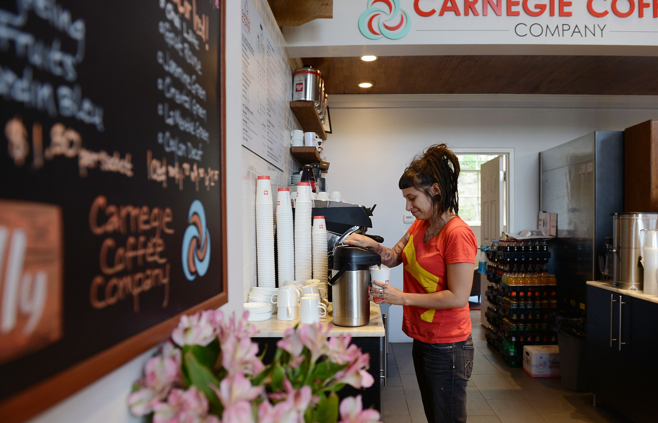 20140724jrMeadFood7-6 Chanel Gallo, 30, of Mount Washington, serves coffee Thursday morning at Carnegie Coffee in Carnegie.
