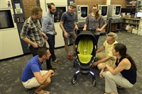 Some employees of 4moms, a Strip District company that makes innovative baby products, with their Origami baby stroller. From left is Jim Darr, Elija Wiegmann, Parker Trow, Sean Beaudette, Jessica Butala, Kevin Dowling and Mara McFadden.