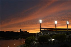 The sun sets over an empty PNC Park on Oct. 9, 2013, a night when crowds gathered outside the park to watch Game 5 of the National League Division Series, being played in St. Louis.