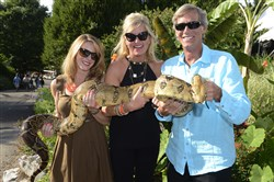 Erin Fusaro, Debbie Flaherty and Jimmy Campbell with a boa constrictor snake at a previous Summer Safari.