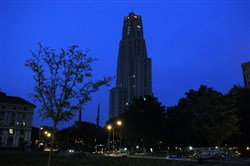 Few lights shine at the Cathedral of Learning on the University of Pittsburgh campus in Oakland.