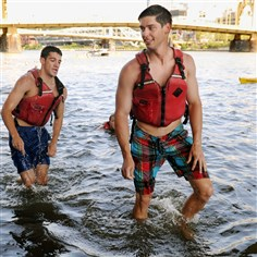 Mike Harris, left, and Alden Galvin, employees of PwC Pittsburgh Mike Harris, left, and Alden Galvin, employees of PwC Pittsburgh, jumped into the Allegheny River on Friday to raise money for Against Malaria Foundation. This is the seventh year the company took part in the event. It raised about $8,000 this year.